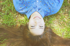 Happy. Young woman on the grass Stock Photo