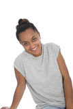 Happy Young Woman in Gray Shirt Leaning on Floor. Close up Happy Young Asian Indian Woman in Casual Gray Shirt Leaning on the Floor While Smiling at the Camera Royalty Free Stock Photo