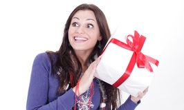 Happy young woman with a great gift .isolated on a white Royalty Free Stock Images