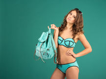 Happy young woman in green bikini swimsuit posing Royalty Free Stock Photography