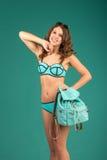 Happy young woman in green bikini swimsuit posing Stock Image