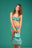 Happy young woman in green bikini swimsuit posing Stock Photos