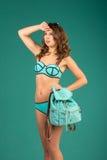 Happy young woman in green bikini swimsuit posing Stock Photo