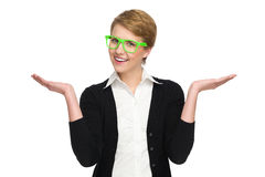 Happy young woman in green glasses with raised hands. Waist up studio shot isolated on white Royalty Free Stock Photography