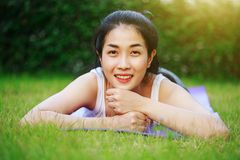 Happy woman on the green grass field Stock Image