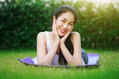 Happy woman on the green grass field Stock Photography