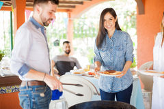 Happy young woman at a grill stock photo