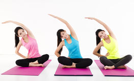 Happy young woman Group  doing yoga exercises Stock Images