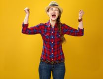 Happy young woman grower on yellow background rejoicing Stock Images