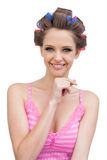 Happy young woman with hair curlers Stock Photos