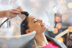 Happy young woman at hair salon royalty free stock photo