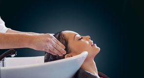 Happy young woman at hair salon Royalty Free Stock Photography