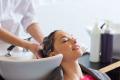Happy young woman at hair salon Royalty Free Stock Images
