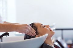 Happy young woman at hair salon Royalty Free Stock Photos