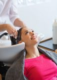 Happy young woman at hair salon Stock Images