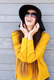 Happy young woman with hands by face in sunglasses Stock Photos