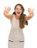 Happy young woman with hands stretched forward. Isolated on white stock photos