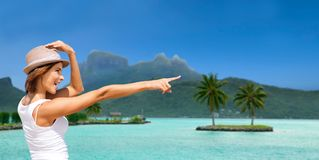 Happy young woman in hat on bora bora beach Royalty Free Stock Photography