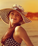 Happy young woman in hat joy on sunny sea. Background. Closeup bright portrait royalty free stock photo