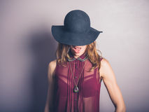 Happy young woman in hat and see through shirt Stock Image