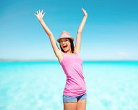 Happy young woman in hat on summer beach Royalty Free Stock Photos