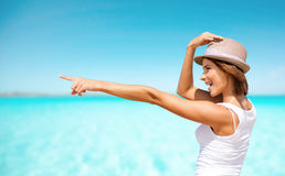 Happy young woman in hat on summer beach royalty free stock images