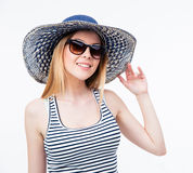 Happy young woman in hat and sunglasses Royalty Free Stock Image