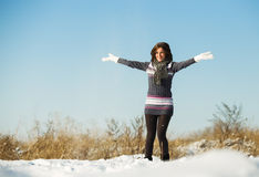 Happy young woman have fun and enjoy fresh snow Royalty Free Stock Photo