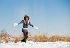 Happy young woman have fun and enjoy fresh snow Stock Images