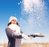 Happy young woman have fun and enjoy fresh snow Stock Photos