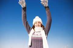 Happy young woman have fun and enjoy fresh snow Royalty Free Stock Photography