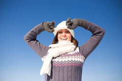 Happy young woman have fun and enjoy fresh snow Stock Image