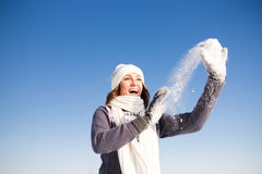 Happy young woman have fun and enjoy fresh snow Stock Photography