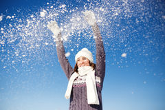 Happy young woman have fun and enjoy fresh snow Royalty Free Stock Image
