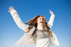 Happy young woman have fun and enjoy fresh snow Royalty Free Stock Photos