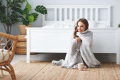 Happy young woman having coffee in morning in bed royalty free stock photo