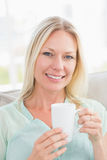 Happy young woman having coffee Stock Photography