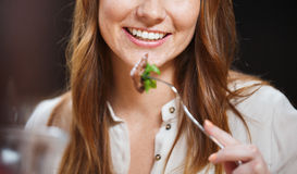 Happy young woman having dinner at restaurant Royalty Free Stock Photography