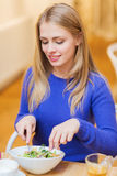 Happy young woman having dinner at restaurant Stock Images