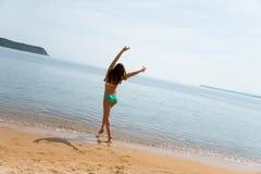 Happy young woman having fun on beach Stock Photos