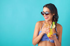 Happy young woman having fun with cocktails Royalty Free Stock Images