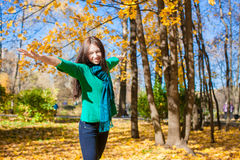 Happy young woman having fun her autumn vacation Royalty Free Stock Photo