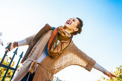 Happy woman having fun time in autumn outdoors Stock Images