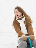 Happy young woman having fun in winter outdoors Royalty Free Stock Photography