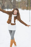Happy young woman having fun in winter outdoors Stock Image