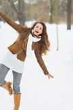 Happy young woman having fun in winter park Royalty Free Stock Photos