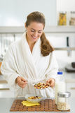 Happy young woman having healthy breakfast Stock Photo