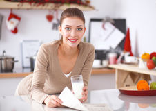 Happy young woman having healthy breakfast in Stock Photography