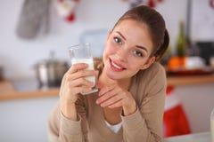 Happy young woman having healthy breakfast in Stock Photos