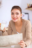 Happy young woman having healthy breakfast in Stock Images
